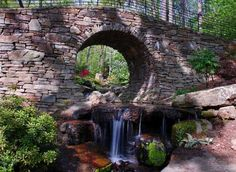 Stone bridge at the University of Arkansas Garvan Woodland Gardens near Hot Springs, Arkansas. The 210 acre site, located on a peninsula on Lake Hamilton, was donated to the School Architecture by Verna Garvan and has been transformed into a formal botanical garden.