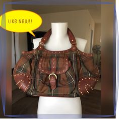 Like New Moschino Cheap and Chic Hobo hand bag  Authentic MOSCHINO Canvas Leather Hobo Bag Bag is Pre-owned, Great Condition Worn few times. Very clean in & out. Light scratches on hardware 100% Authentic Guaranteed Made in Italy Plaid brown color canvas body with brown color leather handle & trims Pewter tone hardware Brown color interior lining Interior features: One zipper  comes with dust bag Moschino Cheap and Chic Bags Hobos