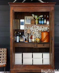 "Home Bar: Drinks are served from the ""barmoire."""
