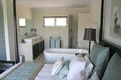 open bathroom with bedroom