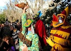 Laurie Thibodeaux Raises A Fake Chicken Into The Air After Catching It In The Courir De Mardi Gras At Vermilionville In Lafayette La Sunday Jan