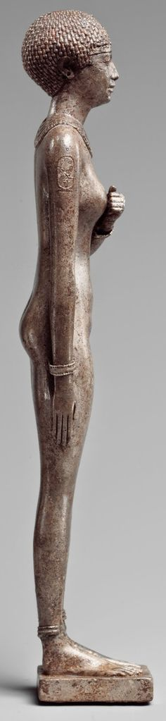 Silver statue of a royal woman (side view) with the cartouches of Necho II on her arms, Egypt, 610–595 BC
