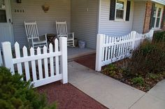 A little added detail to the enclose the front entrance of a house through a fence. The Vande Hey Company, Inc.