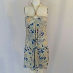 Free People Whimsical Bohemian Halter Dress Whimsical, bohemian multicolor floral printed halter dress by Free People. Bodice with keyhole, bead and braided halter, which ties behind the neck, boning on the sides, empire waist, pleating under the bust, an a-line silhouette, and a smocked rear. 95% rayon, 5% spandex. Excellent condition with no noted flaws. No trades, no PP. Free People Dresses