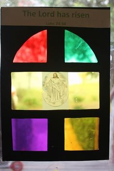 Cellophane stained glass window. Want to replicate this, possibly with tissue paper, with the banner-images for each window of our hall.