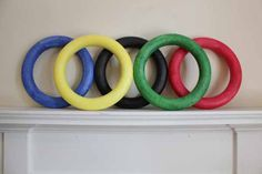 How-to: Olympic Rings Tablescape with painted foam wreaths from Hands Occupied Olympic Idea, Olympic Games Sports, Olympic Gymnastics, Gymnastics Quotes, Gymnastics Events, Olympic Crafts, Olympics Opening Ceremony, Boat Parade, Back To School Party