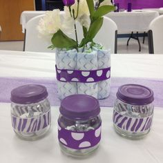 Reused baby food jars as baby shower party favors. Spray paint tops/ wrap ribbon around/ fill with Hershey Kisses #babyshower #partyfavors