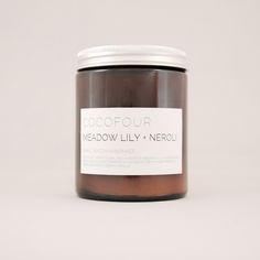 Cocofour Meadow Lily & Neroli Candle: A powder soft woody floral with a heart of meadow lily, jasmine, white neroli and iris wood wrapped in clouds of dreamy musk, precious amber and smooth creamy vanilla. Presented in a glass amber jar with a pre-waxed cotton, hand poured soy candle.