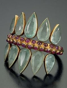 A vintage double-coronet cuff, by Suzanne Belperron, circa 1945-1955. Composed…Aquamarine, ruby and gold. 1945-1955...
