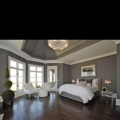 That's the gray of our bedroom walls. Love the sharp white contrast and the dark floors. Definitely the look I'm going for!