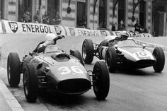 1960 Monaco Grand Prix. Phil Hill, Ferrari Dino 246, 3rd position, waves Bruce McLaren, Cooper T53-Climax, 2nd position, passed in their race duel. Photo by: LAT Photographic