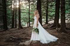 Woodland bridal portraits at Black Balsam Knob near Asheville, NC. Boho lace wedding dress from Wildflower Bridal