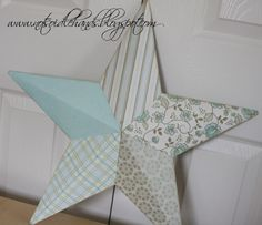 Decorative wall stars.  Cover the discolored stars with your favorite paper or fabric.  So lovely!