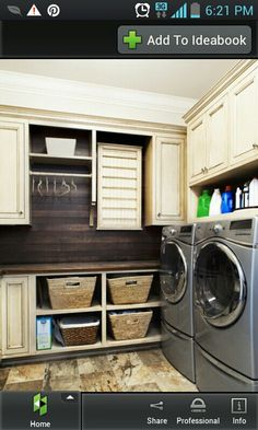 Laundry room - cabinet color, wood paneling, baskets.