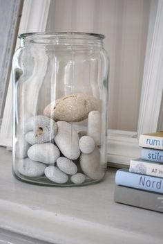 Sea stones in a jar.  Such a simple sweet collection.  Memories of beach combing and treasure hunting.  Every room needs one.