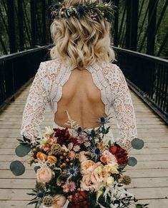 Take a photo holding your bouquet behind you to show off your haistyle and the back of your dress!