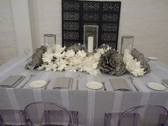 Table linen and centrepieces from Table Art. White Sheer Stripe overlay, black underlay, Black & White Stripe napkins, Silver Hurricanes and Faux floral table runner. www.tableart.com.au