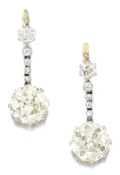 PAIR OF DIAMOND PENDENT EARRINGS, 1920S.  Each set with a circular-cut diamond, suspended from a graduating line of cushion-shaped diamonds, post and hinged back fittings.