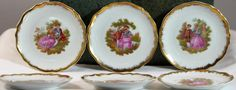 This is a set of 6 miniature collector Limoge plates each featuring a Watteau scene. There are 2 plates of each scene. The plates measure 3 and 1/2 inches in diameter. They are all in excellent condition with no chips or cracks.