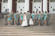 Our wedding party. Teal 1950's style bridesmaids dresses, grey suits, coral-orange roses. Click pic to see where I ordered the dresses from!