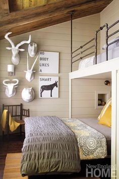 A pipe railing along the upper bunk in a bedroom.