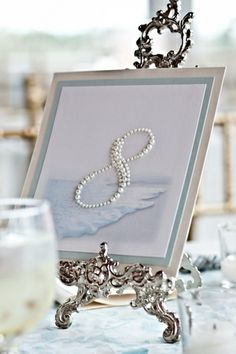 For a beach wedding this is a cute idea. Having the table numbers written with pearls. Wedding Events, Our Wedding, Dream Wedding, Wedding Themes, Trendy Wedding, Wedding Blog, Wedding Table Numbers, Here Comes The Bride, Reception Decorations