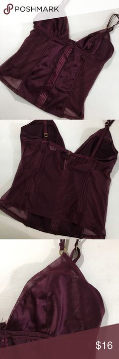 Victoria's Secret Maroon Lingerie Victoria's Secret very sexy maroon lingerie top. Has a silky feel. Mesh on the back and sides. There are a few snags on the front which are pictured, but otherwise in good condition.   ⭐️10% off 2+ bundle  ⭐️Size Small ⭐️Smoke free home  ⭐️No stains or flaws Victoria's Secret Intimates & Sleepwear Chemises & Slips