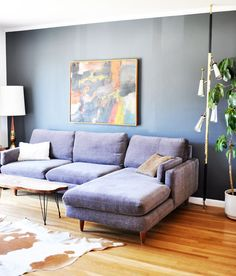 Love the idea of a black accent wall, in a home with lots of natural light. // via SF Girl by Bay