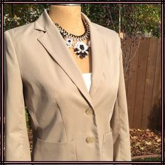 Kenneth Cole Blazer Brand New, flawless Kenneth Cole Blazer in cream/beige with white pinstripes. Fully lined, with two- button closure, pockets and buttoned cuffs. Poly/rayon/spandex blend. Perfectly paired with slacks or over jeans for a variety of looks. From a pet and smoke free home. Kenneth Cole Jackets & Coats Blazers