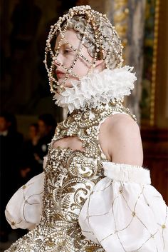 The headdress both complements the Elizabethan feel of the clothing and adds a different element to it.