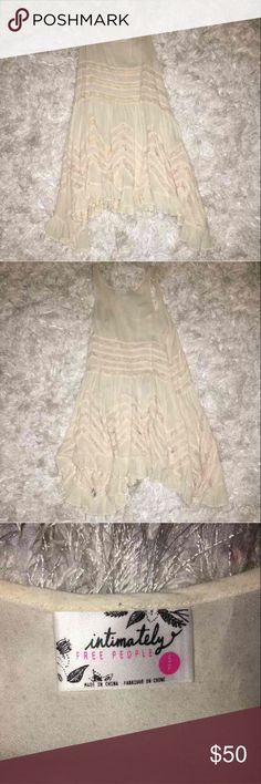 Free People Slip intimately Free People trapeze slip in great condition. cream color with no flaws i just don't wear it anymore. Free People Dresses Asymmetrical