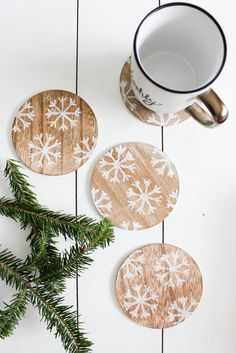 Using simple wooden coasters and snowflake stamp from Target's One Spot, you can create your own set of snowflake coasters to use this winter.