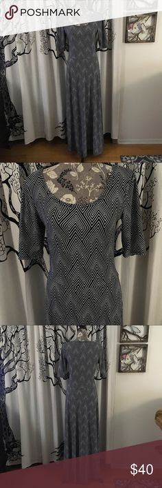 LuLaRoe Graphic Ana Maxi Dress SZ M Amazing Ana Maxi dress by LuLaRoe in classic black and white. Elbow sleeves. Super flattering cut and style. Worn once and in perfect like new condition with no flaws or any signs of wear. True to size in my opinion. Please check measurements.    Beautiful, comfortable dress in a classic color combination that's perfect for warm weather! Red accessories look amazing with this dress!    **Be sure to check out the additional photos for measurements…
