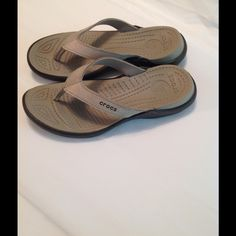 Crocs Gray Flip Flops Sz 7 NWOB Gorgeous gray Crocs flip flops.  False leather gray straps with Crocs written on the side.  Will conform to your feet.  Softer than ordinary flip flops.  Rubber sole.  They are gray color.  Never been worn but I do not have tags or box. crocs Shoes Sandals Crocs Flip Flops, Grey Flip Flops, Crocs Shoes, Shoes Sandals, Fashion Tips, Fashion Design, Fashion Trends, Gray Color, Tags