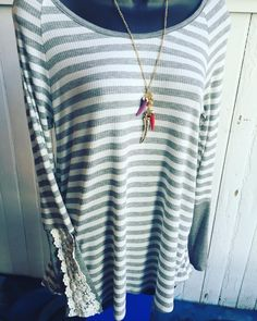 Love lace accents!! Striped tunic with lace detail- $32.95 Statement necklace- $18.95  #madisonsbluebrick #downtownhotsprings #lace #tunic #shoplocal