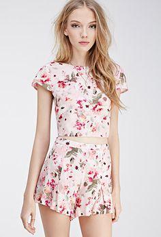 e68c79a48a High-Waisted Rose Print Shorts on ShopperBoard