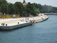 The Sea organ (Croatian: Morske orgulje) is an architectural object located in Zadar, Croatia and an experimental musical instrument which plays music by way of sea waves and tubes located underneath a set of large marble steps. Sound Installation, Adventures Abroad, Save Our Oceans, Concrete Structure, Adriatic Sea, Sea Waves, Urban Planning, Places To See, Musicals