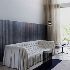 Love this tufted/slipcover from Busnelli!