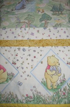 Love this Classic Winnie the Pooh themed baby quilt. The colors are so soft, it is perfect for baby's nursery. #winniethepooh #babyquilts