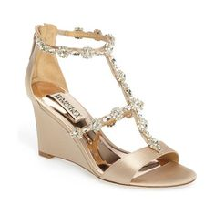 tabby embellished wedge sandal by Badgley Mischka. Sparkling floral clusters and marquise crystals parade along the slender intersecting straps of a wedge sandal in pale shimmery satin.  #badgleymischka #nudeshoes #wedges