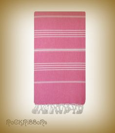 Fuchsia cotton traditional turkish hammam towel. This fashionable, handwoven, affordable, and lightweight beach accessory is made of 100% organic turkish cotton and makes the perfect beach towel, bath towel, sarong and pareo. $35.00