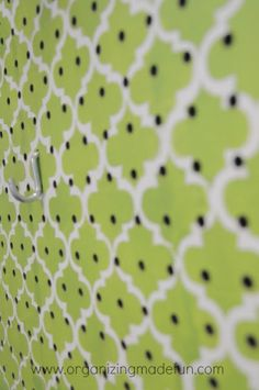 another lovely pegboard    Laundry Room wall with stencilled pegboard to cover ugly pipes | OrganizingMadeFun.com