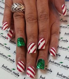 Christmas nails-Red&white stripes with green accent nail. Looks like wrapping paper! (: