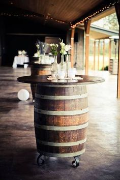 With their rustic charm and versatility, whiskey (and wine) barrels are an easy way to really bring your wedding decor from drab to fab. From flowers stands, to cocktail tables we've found some great whiskey barrel styling ideas for your big day! Barn Wedding Decorations, Table Decorations, Wedding Ideas, Wedding Venues, Barn Weddings, Vintage Weddings, Outdoor Weddings, Diy Wedding Tables, Wedding Details
