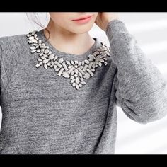 Gray J.Crew sweatshirt with Jeweled collar Gorgeous gray J.Crew sweater with white jewels at the collar. One jewel is missing, see picture, priced accordingly. Otherwise in excellent condition J. Crew Tops Sweatshirts & Hoodies