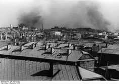 Smoke rising from various districts of Stalingrad, Russia, 30 Sep 1942.  --Looking southeast toward central Stalingrad. At left, the water tower is 1.7 km away.