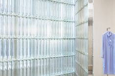Studio David Thulstrup combines pale pink panels, glass bricks and birch veneer in this minimalist store in Copenhagen for designer Mark Kenly Domino Tan. Grey Painted Walls, Neutral Walls, Metal Clothes Rack, Daybed Covers, Glass Brick, Commercial Interiors, Retail Design, Brick Wall, Store Design