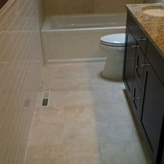DIY tips for small bathroom floor tile layout. How to draw square layout lines, make adjustments. Photos and diagrams of where to start and what to measure.