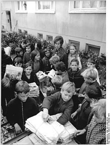 A paper recycling drive to fund the 1973 World Festival of Youth and Students in East Berlin. The pioneers took part in a range of activities including sports, ceremonies and performances, meetings and waste collection for different causes. In their uniforms, and with their children's enthusiasm, they were an attractive accompaniment to GDR anniversaries and festivals. In 1966, for example, a delegation of children from the Pioneers and the FDJ symbolically handed over a bunch of red…
