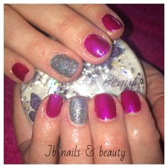 Purple gel polish on natural nails with glitter